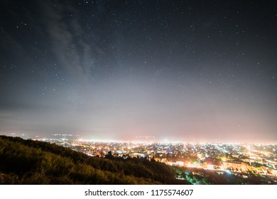 The top view of the big city, the night sky and many luminous lights