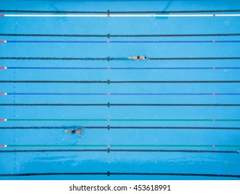 Top View, Bird Eye View of Blue Swimming Pool with Swimmers.