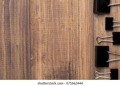 Top view of Black clip in pattern on dark wooden background