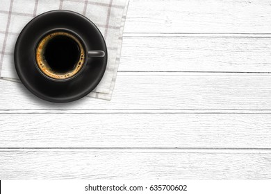 Top view of a black coffee cup on wood background with copy space.