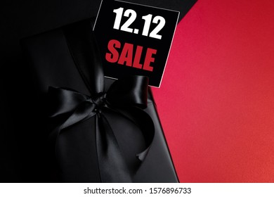 Top view of black gift box with black background with copy space for text 12.12 singles day sale. Online shopping of China, 12.12 singles day sale concept.