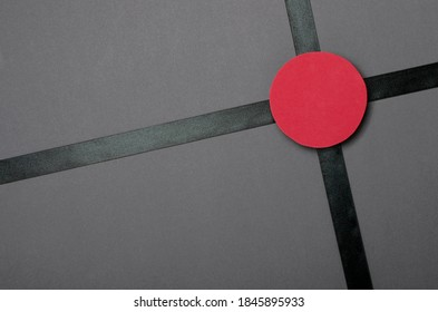 Top view of black shiny ribbon and red circle for prace of sale text on it.Blank space - Shutterstock ID 1845895933
