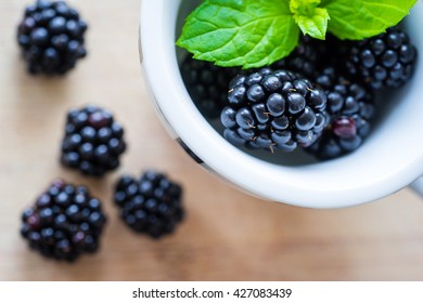 Top view of blackberries on a wooden table. Selective focus. Horizontal shot.