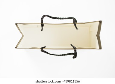 Top view of blank inside  paper bag isolated on white background.