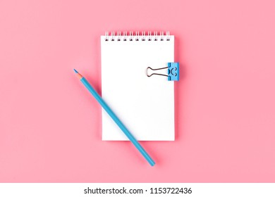 Top view of Blank notebook with peb on colorful background pink with copy space.