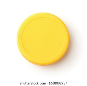 Top view of blank plastic yellow bottle cap isolated on white