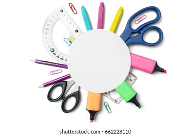 Top view of a blank round paper over school supplies, isolated on white background