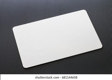 Top view of blank white business card mockup with rounded corners on black textured background. Used for credit namecard display front used design for branding.
