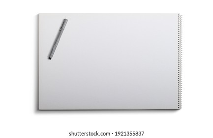 Top view blank white spiral notebook with pen isolated on white background