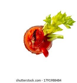 Top view of Bloody Mary cocktail with vodka, lemon and tomato juice, tabasco sauce and ice cubes decorated with celery leaves and red pepper glass rim