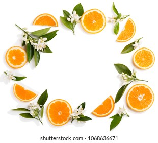 Top view of blossom of orange tree with leaves and sliced orange fruit, isolated on white background.