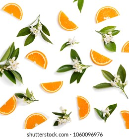 Top view of blossoming branches of orange tree with leaves and sliced orange fruit, isolated on white background.