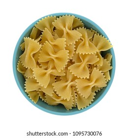 Top view of a blue bowl filled with bow tie pasta isolated on a white background.