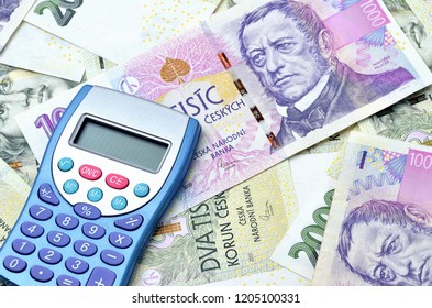 Top view of blue calculator on czech crowns CZK - concept of financial background