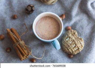 top view blue cocoa cup gray knitted background