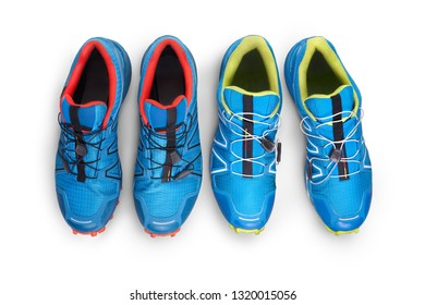 Top view of blue, orange and yellow trainers isolated on a white background.
