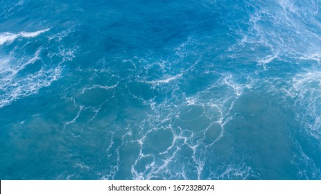 Top view of blue waves with natural water texture background