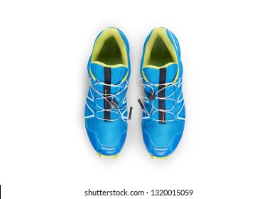 Top view of blue and yellow trainers isolated on a white background.