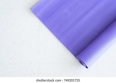 Top view blue yoga mat on white floor at indoor yoga class room.Sport tool concept.