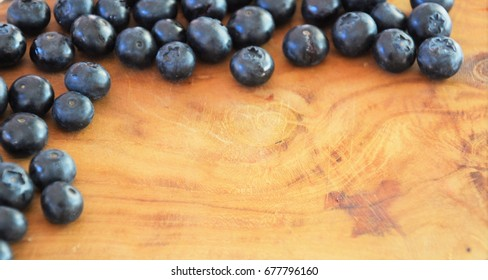 Top view of blueberries stack on wood.
