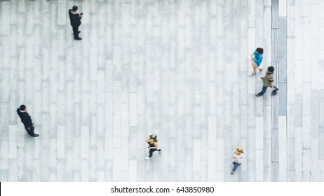 top view of blur people walk and stand on the white concrete pedestrian landscape.