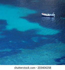 top view of a boat in turquoise sea