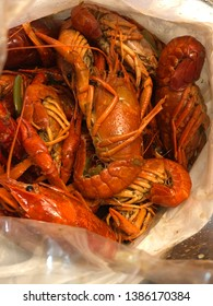 Top view of boiled crawfish in a plastic bag. Crawfish, aka freshwater lobsters or yabbies are freshwater crustaceans resembling small lobsters. They are famous and well known in Louisiana, USA.