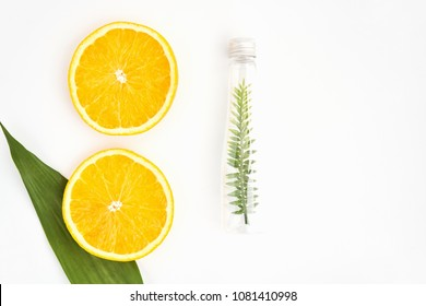 Top view, Bottle of natural oil and orange, Blank label package for mockup on white background. The concept of natural beauty products.