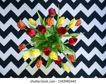 top view of bouquet of yellow and red tulips