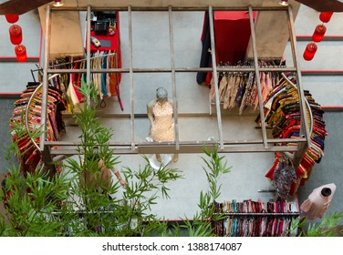 Top view of the boutique selling colorful Chinese cheongsam during Chinese New Year.