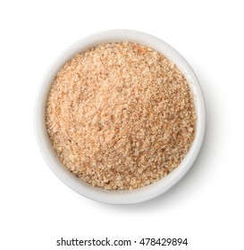 Top view of bowl full of breadcrumbs isolated on white