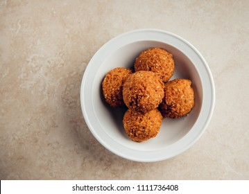 A top view of a bowl full of deep fried Falafils- a favorite African and Middle Eastern snack or appetizer.