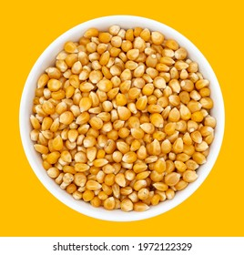 Top view of bowl with Popcorn Kernels Uncooked. Popcorn Kernels Uncooked in a Ceramic Bowl. The image is a cut out, isolated on a white background, with a clipping path