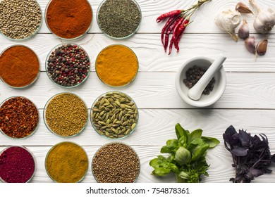 Top view of bowls with spices and mortar with pestle