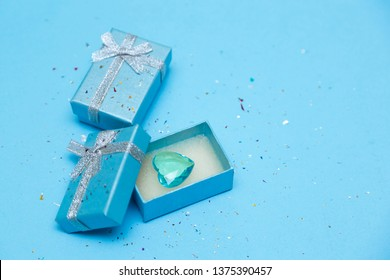 Top view of the box, tied with a silk silver ribbon on Tiffany blue pastel background. The festive gift of choice. long wide banner with copy space