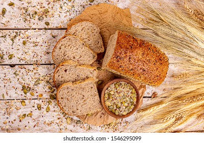 Top view of bread with different seeds, pumpkin, poppy, flax, sunflower, sesame