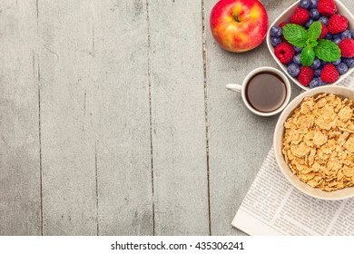 Top view of breakfast meal over wooden table