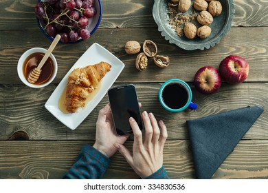 top view of a breakfast table and hands of a woman