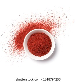Top view of bright paprika powder in bowl for aromatic food isolated on white background