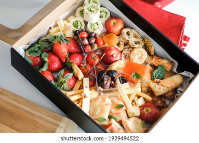 top view bright photo of beautiful healthy finger food in box for lunch party