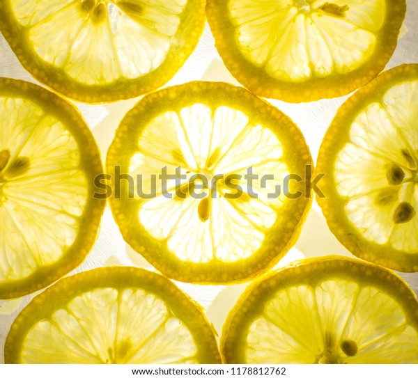 Top view of bright yellow lemon slices