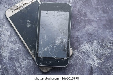 top view of broken smart phone on white background