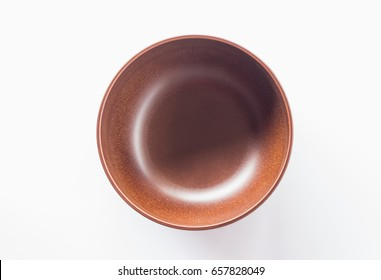 top view of brown bowl on white background
