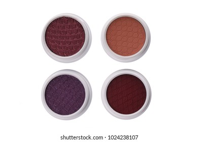 Top view of brown eye shadows, isolated on white background