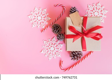 top view brown gift box and christmas decoration for new year on pink pastel color.