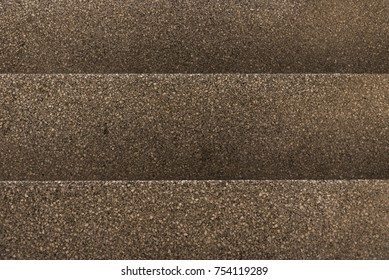 Top view of brown gravel stairs. background texture