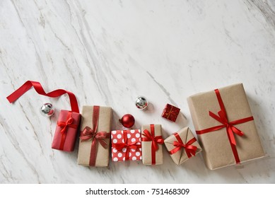 Top view of Brown and Red gift boxes on white marble background for Christmas and New year. Copy space.
