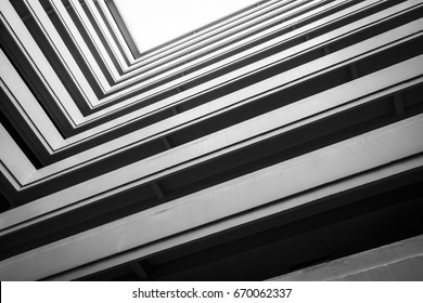 Top View Building, looking up to cement building. Modern architecture, cement Abstract architectural design. Inspirational, artistic image. Industrial design. .Modern building. Black and white.