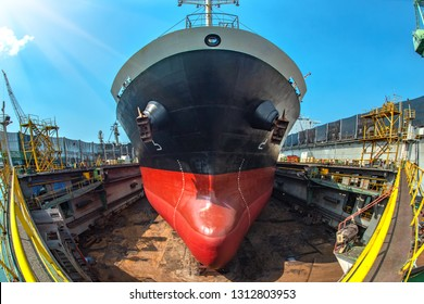 Top view of bulk head of the commercial bulk ship sitting on supporters of floating dry dock, after completed recondition of sand blasting and painting, ready to delivery to the sea services