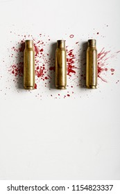 Top view of bullet shells with vlood splatter
